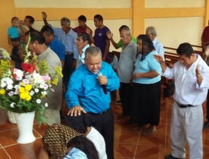 Special prayer time at a church alter in Mexican sate of Pueblo.