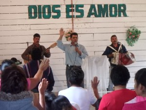 Pastor Jose lead a spirited time of song.