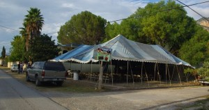 The tent covered the entire lot.