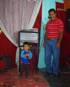 Even Pastor Rey's youngest, Elias, is happy with the new sound system.
