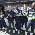 "As Dolphins Players Kneel for Anthem, Russell Wilson & Seahawks Stand in a ""demonstration of unity"""