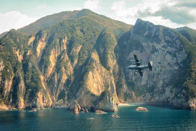 a-c-130-hercules-flies-over-izu-peninsula-japan