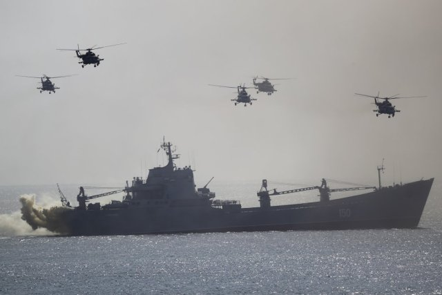 a-russian-navy-ship-and-helicopters-take-part-in-a-landing-operation-during-military-drills-at-the-black-sea-coast-crimea-friday-september-9-2016