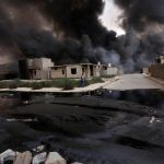 Apocalyptic scenes as fleeing ISIS fighters bomb Iraqi town's pipelines leaving rivers of oil and streets on fire