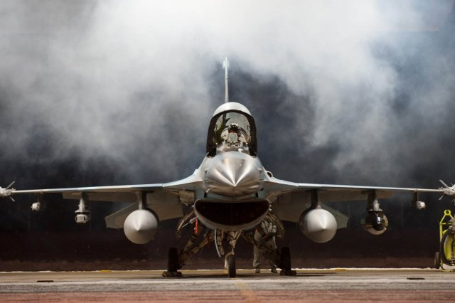 lt-col-mark-sletten-an-f-35-lightning-ii-program-integration-officer-lowers-the-canopy-on-an-f-16-fighting-falcon-before-taxiing-to-take-off