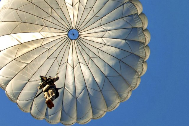 paratroopers-descend-onto-fort-braggs-sicily-drop-zone-after-exiting-an-air-force-c-130-aircraft-over-fort-bragg