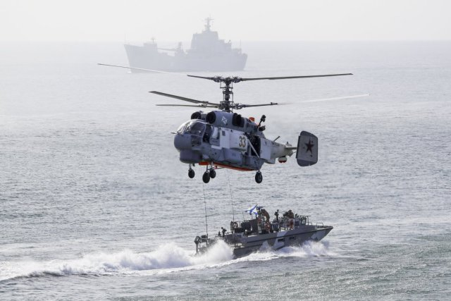 russian-helicopters-and-boats-work-in-conjunction-for-a-landing-operation