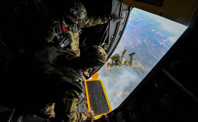 special-tactics-airmen-from-the-24th-special-operations-wing-jump-out-of-an-mc-130h-combat-talon-ii-at-hurlburt-field