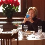 Table for one: Hillary spotted having breakfast alone