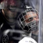 Photographer capture an incredible photo of Justin Bieber getting smashed into the boards during NHL All-Star Celebrity game