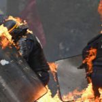 VIDEO: Cops Engulfed In Flames At May Day Protest, Forced To Deal With Flaming Dragon
