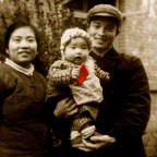 "My dad was sent to Xichang, an outpost, to ""reform"" and ""serve the people"" when I was born. Dad saw me, his firstborn, for the first time when I was seven-month-old. The Little Red Book in my hand served as the standard photo pop and rattle for a baby. I looked a little rattled—the photographer was shining too much light on me with a rice-bowl-sized Mao pin."