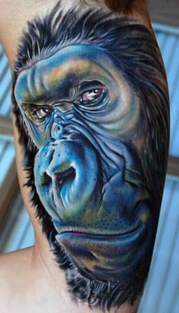 Blue Ink Amazing Monkey Animal Face Tattoo On Biceps