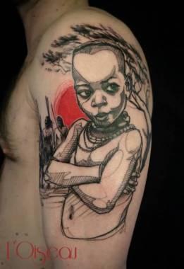 Cool Black Ink African Kid Tattoo On Shoulder