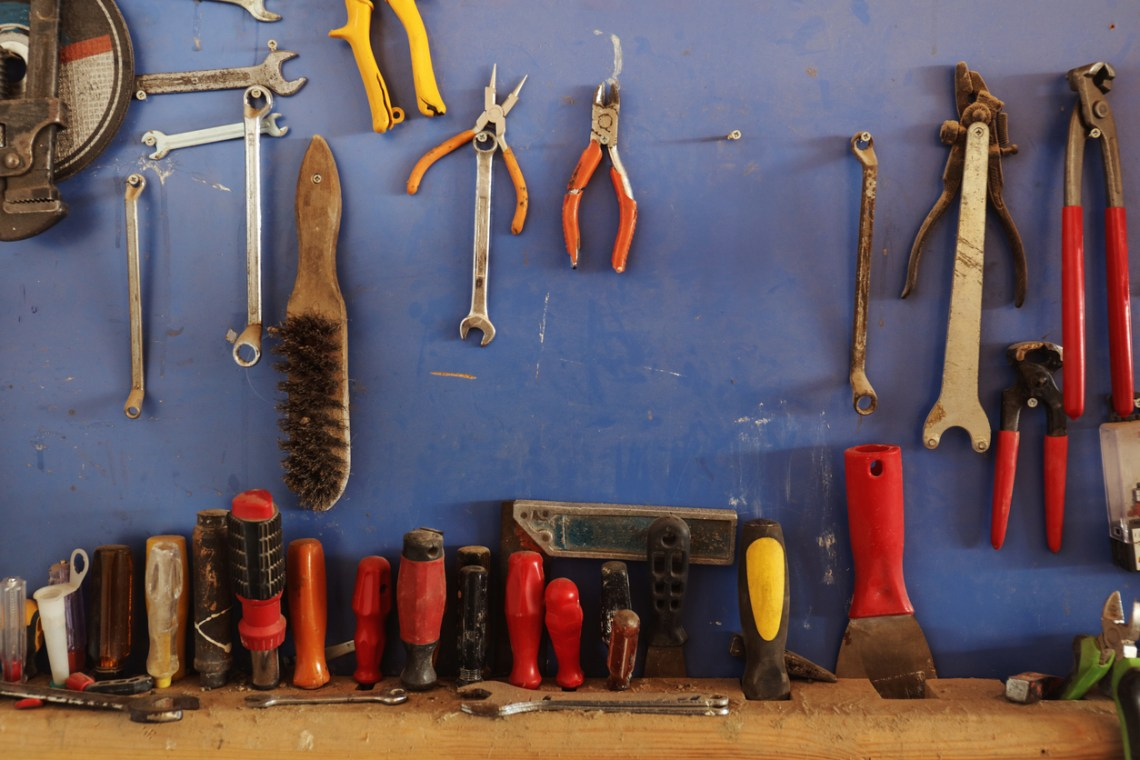 Various hand tools arranged on wood