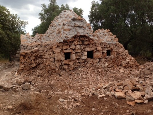 Demolishing the side trullo