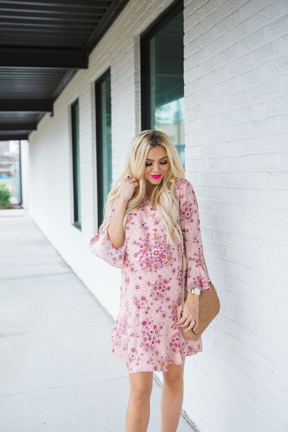 Love this floral dress that is not maternity but bump friendly! A great dress to be able to wear during pregnancy and after!