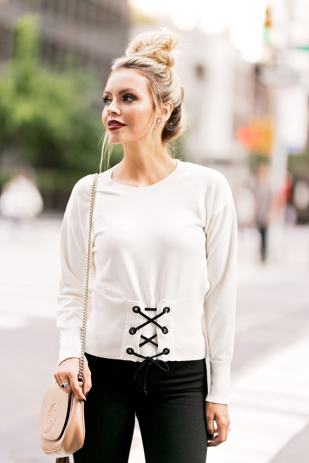 I am crushing on this corset sweater that completes this neutral look with black legging and nude heels!