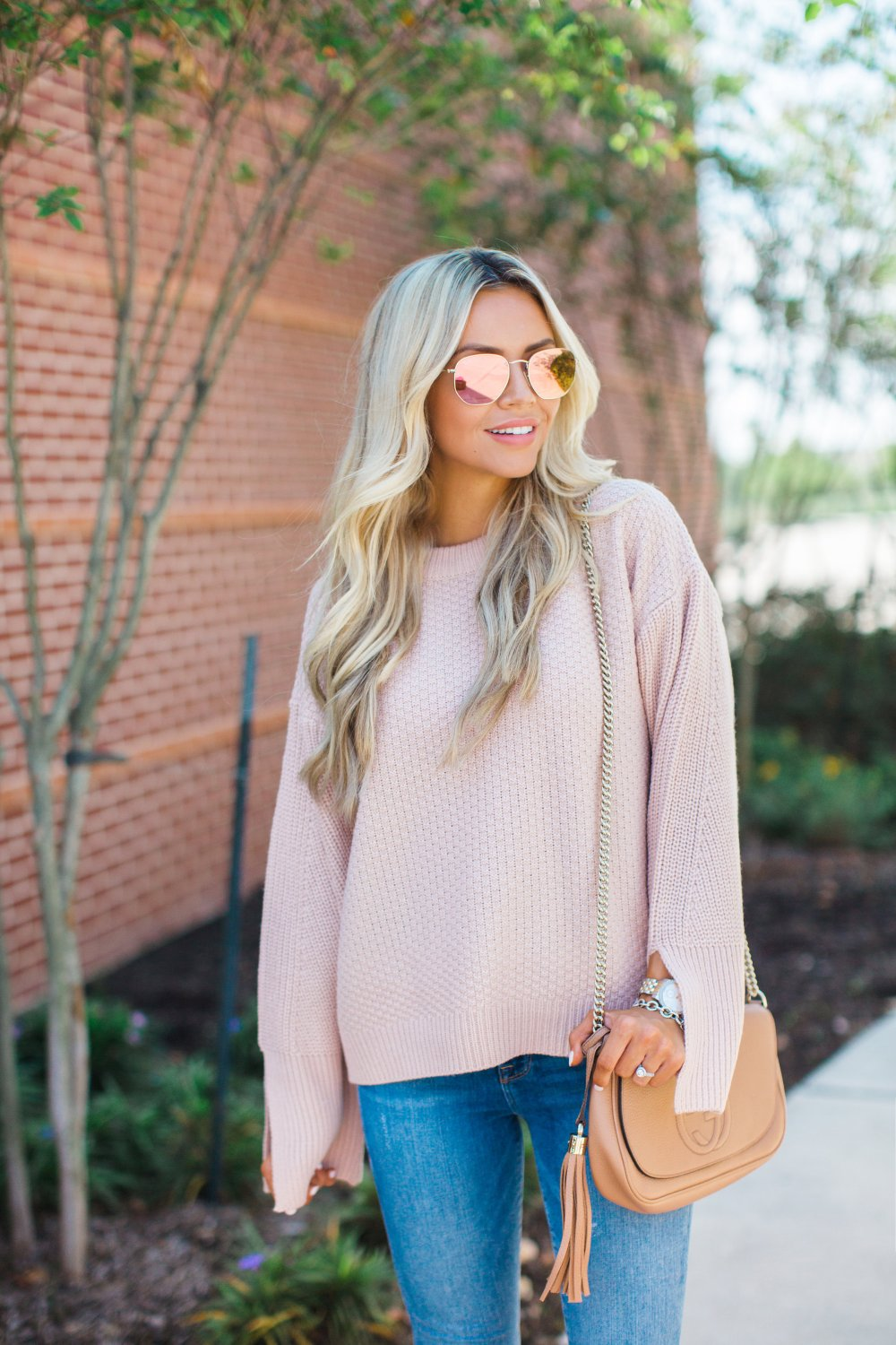 The perfect Fall Blush Sweater that has great sleeve detail! Pair with nudes or dark hues for a bold look!