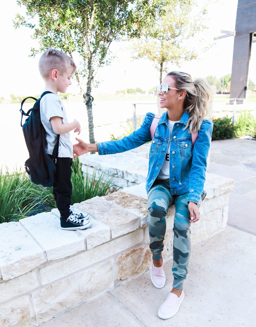 A simple but stylish mom outfit, perfect for running errands! Camo pants and graphic tee with jean jacket! This diaper bag is love!