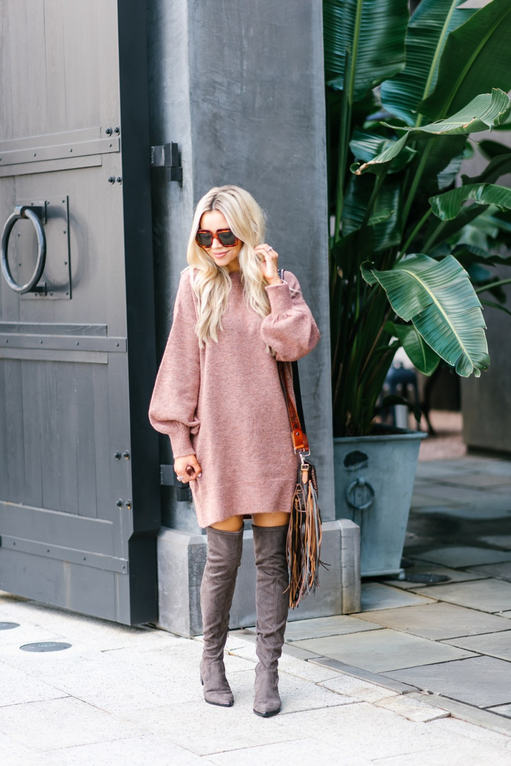 Fall staple clothing item! This over-sized sweater dress can be worn so many ways! Over the knee boots are giving the outfit a chic look!