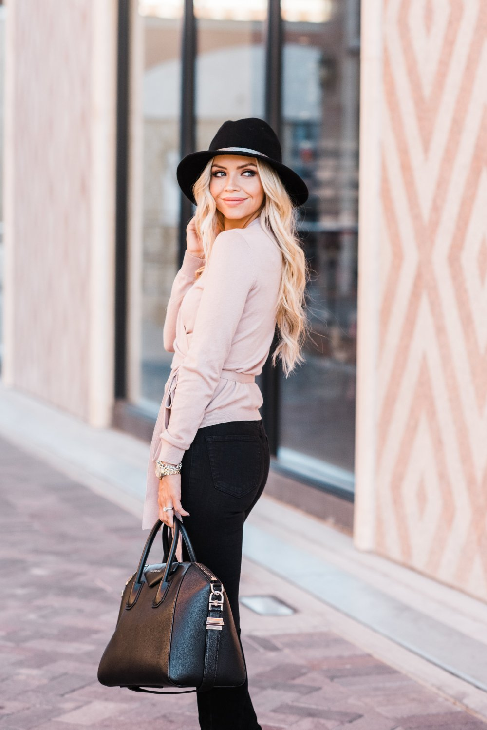 This pink wrap sweater is to die for! It is perfect for spanning multiple seasons and it is SO soft! This pink color and the bow details make it very feminine! The black wool floppy hat is the perfect accessory!