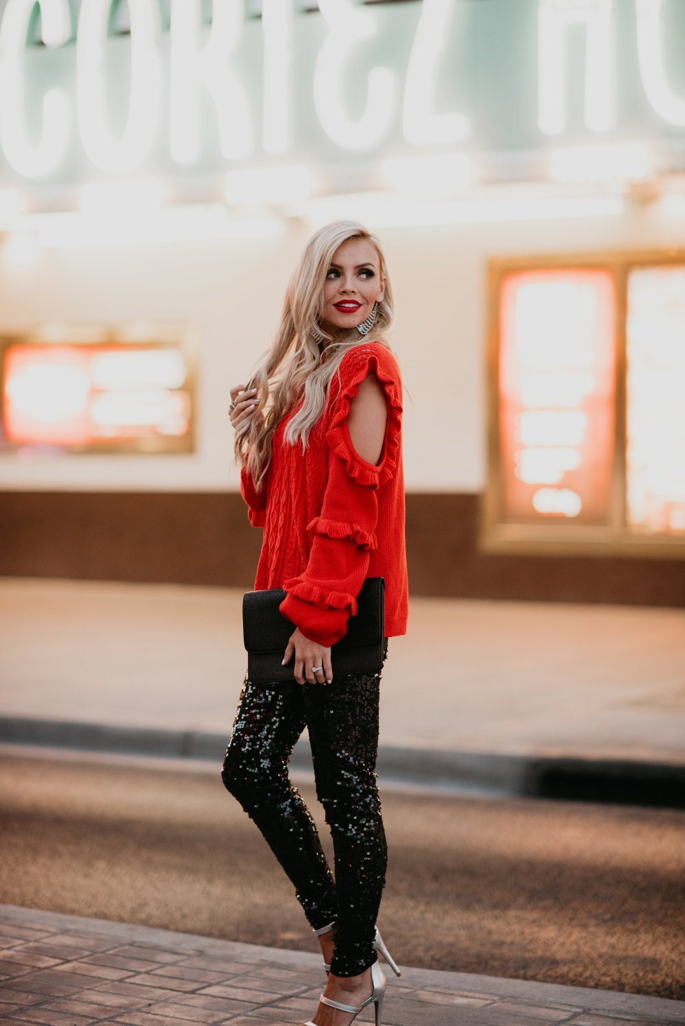 What is your Holiday Style? I love the glam look with these sequin pants and POP of red sweater! The key hole and ruffles on the arm are perfect details! These pants can be worn for Christmas and New Years! Get this glam look from Express today for your holiday parties! #trulydestiny #holidayglam #holidayoutfit