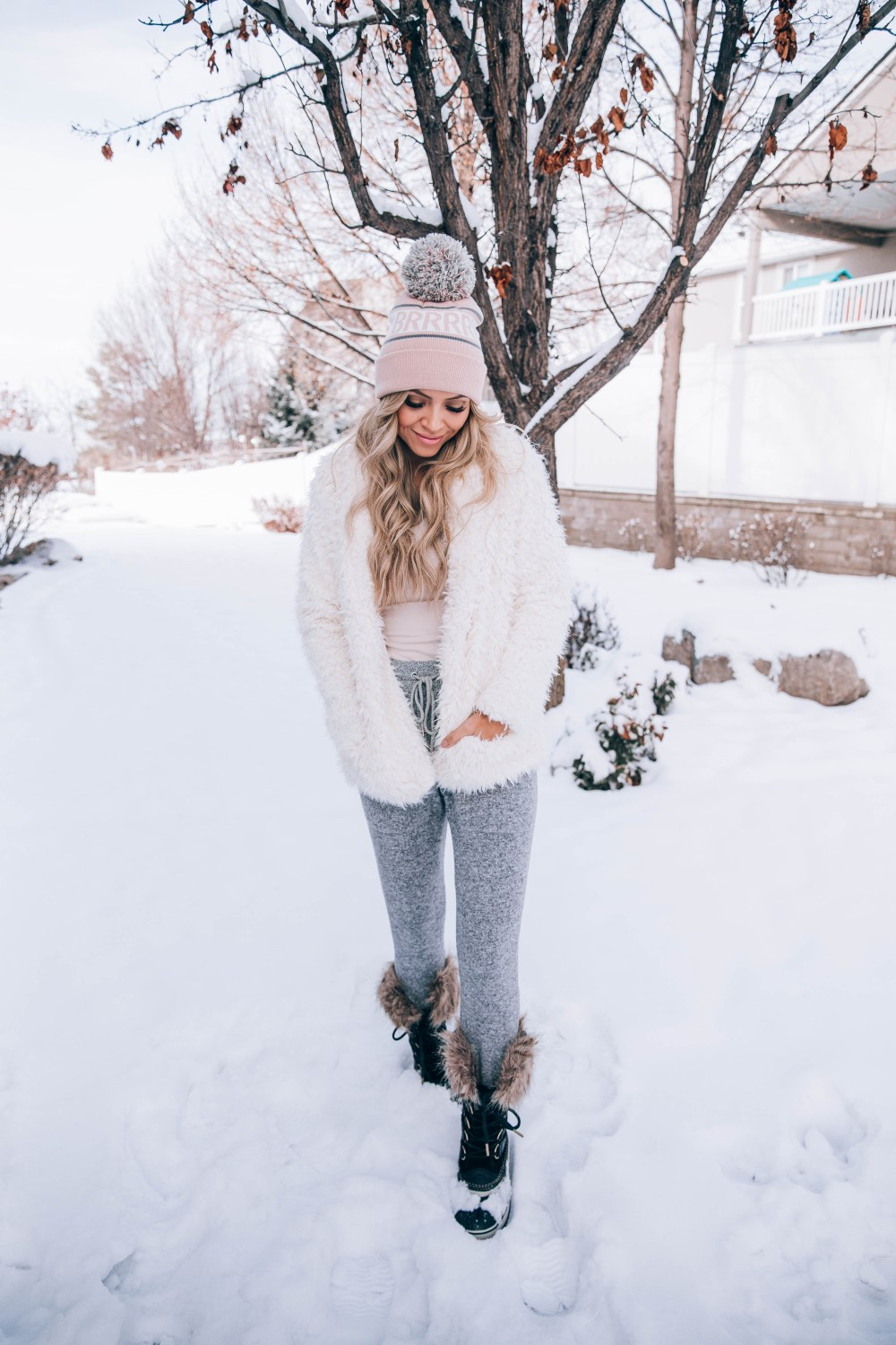 I found the best snow boots that are cute and keep my feet cozy warm! Also listing some other winter essentials to brave the cold weather! The large pom beanie is my favorite! #winterfashion #fashion #trulydestiny
