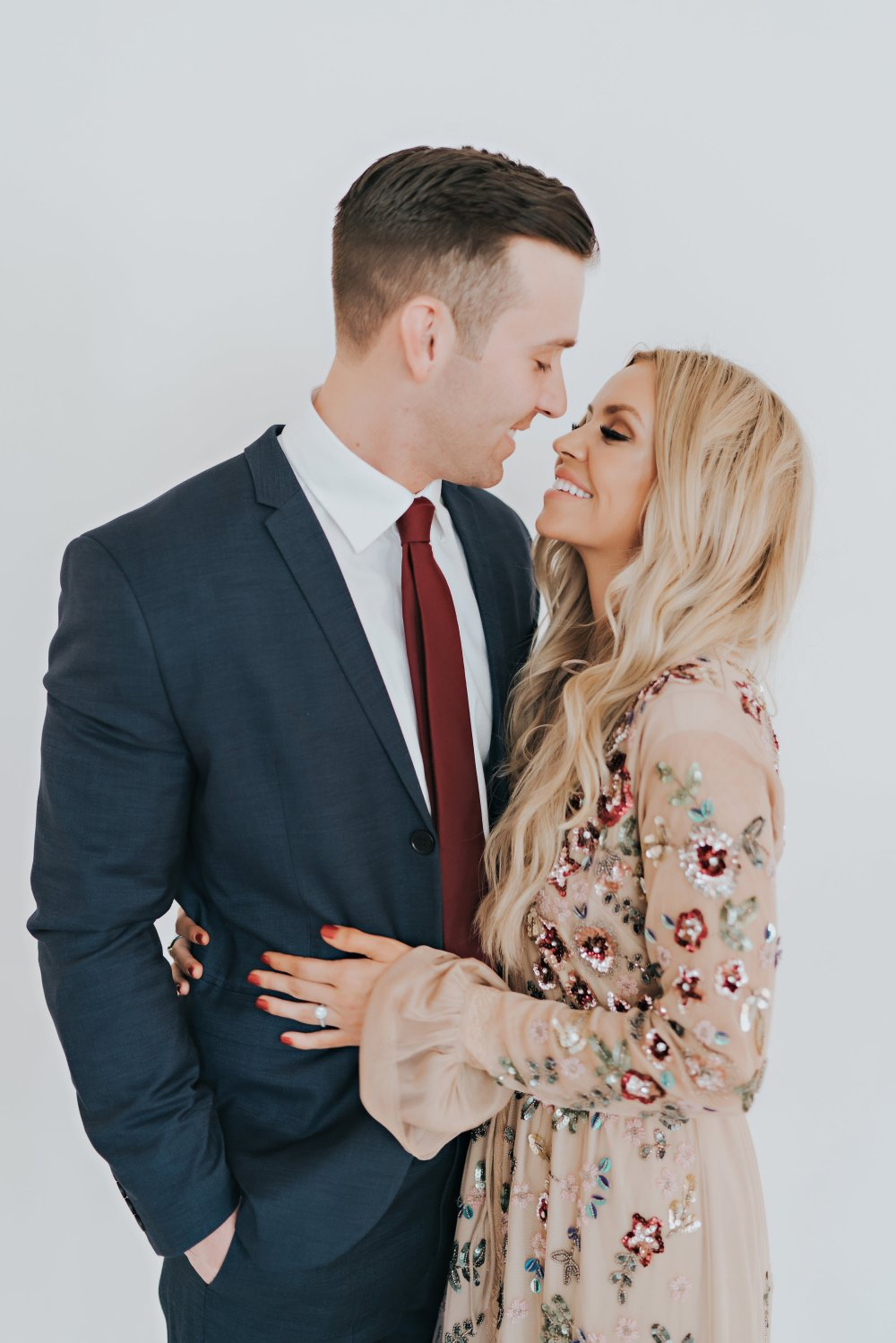 My love! Even though we are a family of four, always make sure to get a photo with just your spouse! Our outfits would also be perfect for weddings, parties or any special occasion! #familyphotos #couplephotos #coordinatingoutfits #specialoccasionoutfits