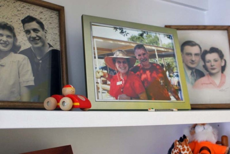 Showcase family pictures in baby's nursery, particularly for (grand)parent memorials