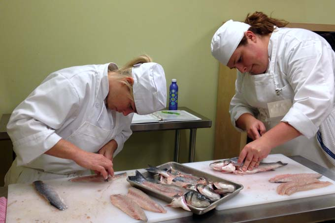 Braise Students Filleting Fish