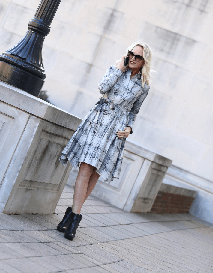 Dallas style blogger Megan Saustad wears Worth New York silver plaid shirt dress from the Winter 2018 collection and Tory Burch black booties.