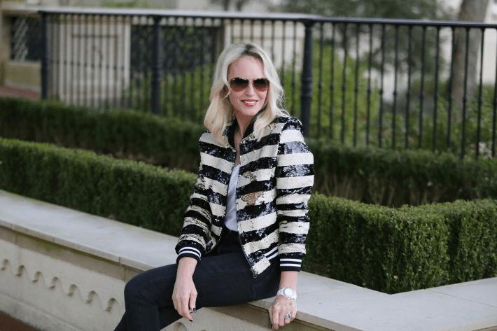 Dallas fashion & lifestyle blogger Megan Saustad of 'Truly Megan' wearing striped sequin bomber jacket.