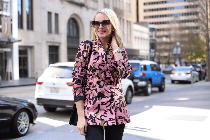 Style blogger in Downtown Dallas wearing pink jacquard animal print jacket and prada sunglasses.