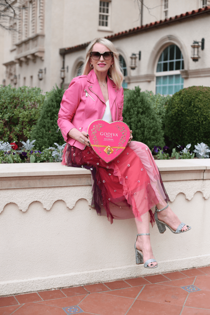 Style blogger 'Truly Megan' wearing pink moto jacket and tulle skirt for Valentine's Day outfit.