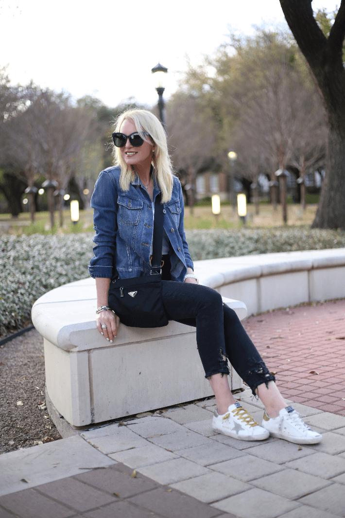 Dallas fashion blogger Megan Saustad wearing Golden Goose Deluxe Brand sneakers and Prada crossbody bag.