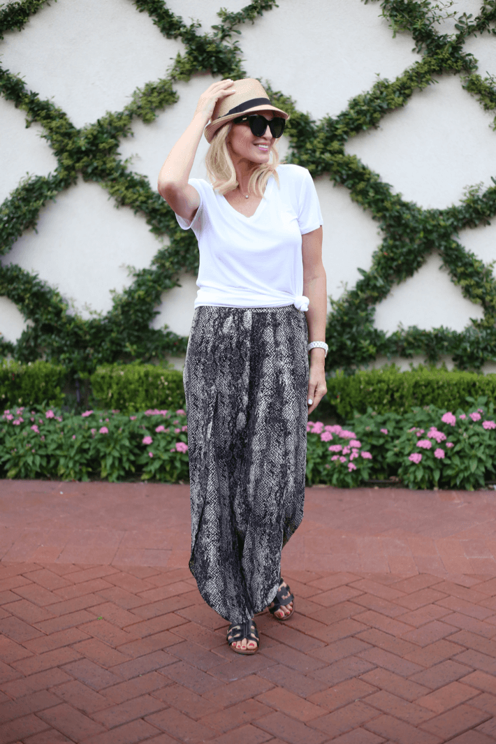 Style blogger Truly Megan wearing Whitney Pant from Evereve in snake print, Eric Javits straw fedora, Le Spec Air Heart Sunglasses.