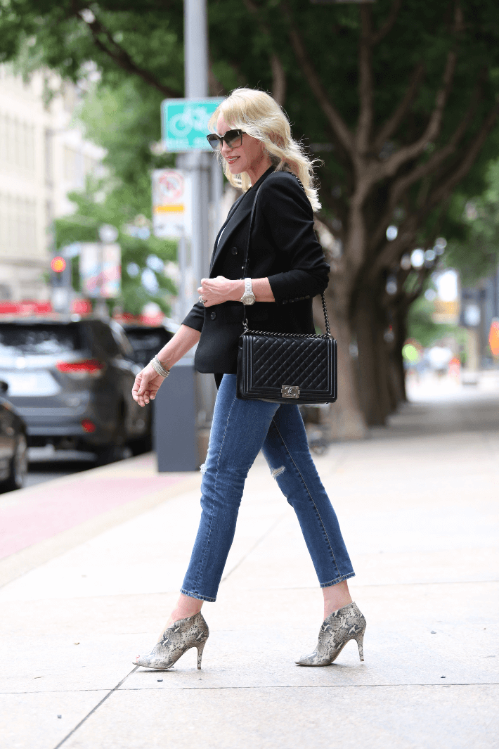 Dallas style blogger Truly Megan wearing black blazer and carrying Chanel Boy Bag.