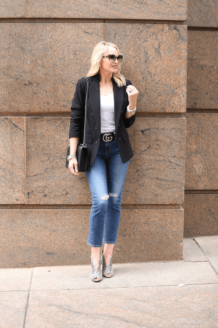 Style blogger wearing black 1.State Blazer, Gucci Belt, AG Boyfriend Jeans and Halogen Rowen Booties.