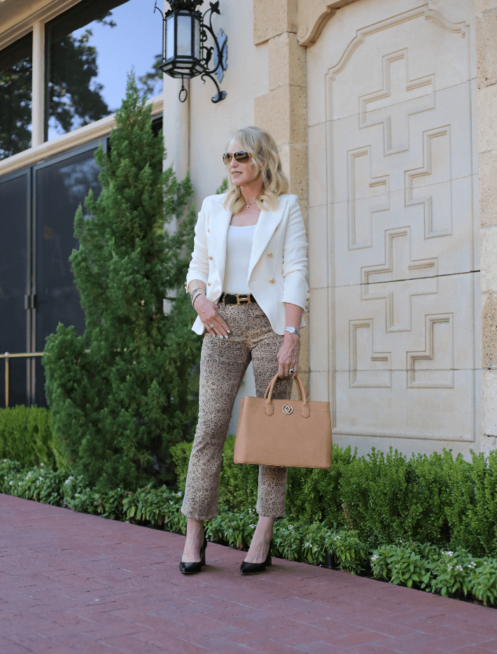 Dallas fashion blogger Truly Megan wearing Lioness White Blazer, Frame leopard jeans and Hermés belt.