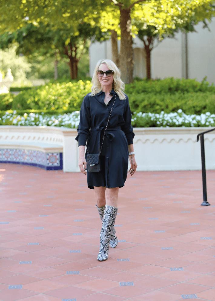 Style blogger Megan Saustad wearing Peach Safari Shirtdress and snake print boots.