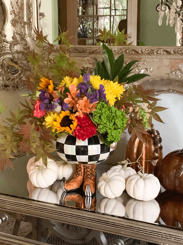 Dallas lifestyle blogger Megan Saustad displays the Mackenzie Childs Courtly Checked Cauldron filled with fresh autumn flowers.