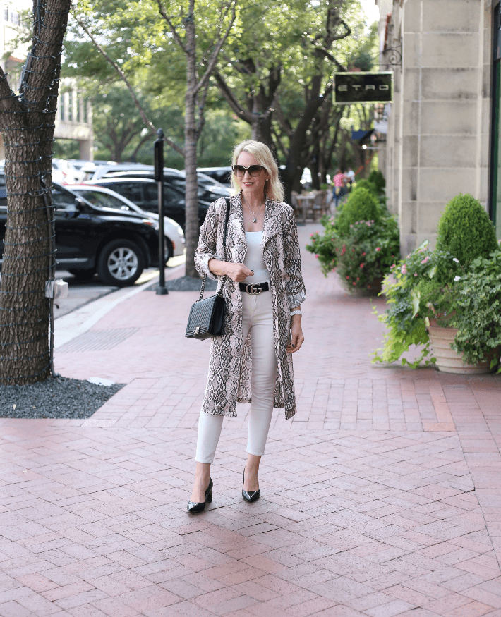 Dallas blogger Megan Saustad wears snake print trench, skinny jeans and Chanel Boy Bag.