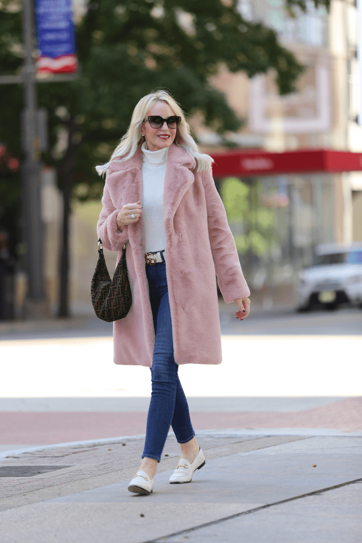 Dallas style blogger Truly Megan wearing Lovers + Friends Pink Faux Fur Coat, Gucci Brixton flats and carrying Fendi Zucca hobo handbag.