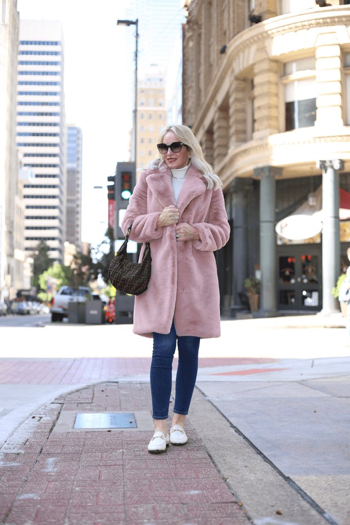 Dallas style blogger Truly Megan wearing Lovers + Friends Romy Pink Faux Fur Coat, Gucci Brixton flats and carrying Fendi Zucca hobo handbag.