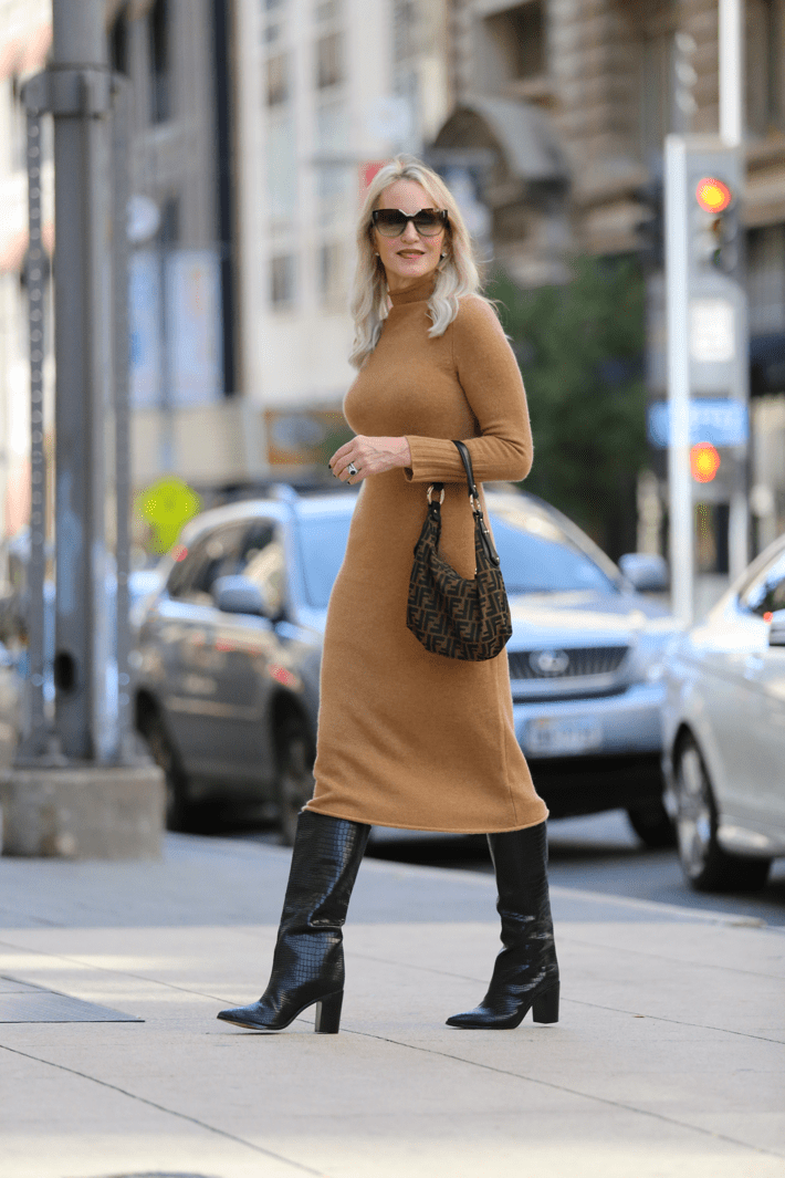 Dallas blogger Megan Saustad wearing Madewell Camel Cashmere midi sweater dress, Schutz Croc embossed boots and carrying Fendi Zucca hobo bag.
