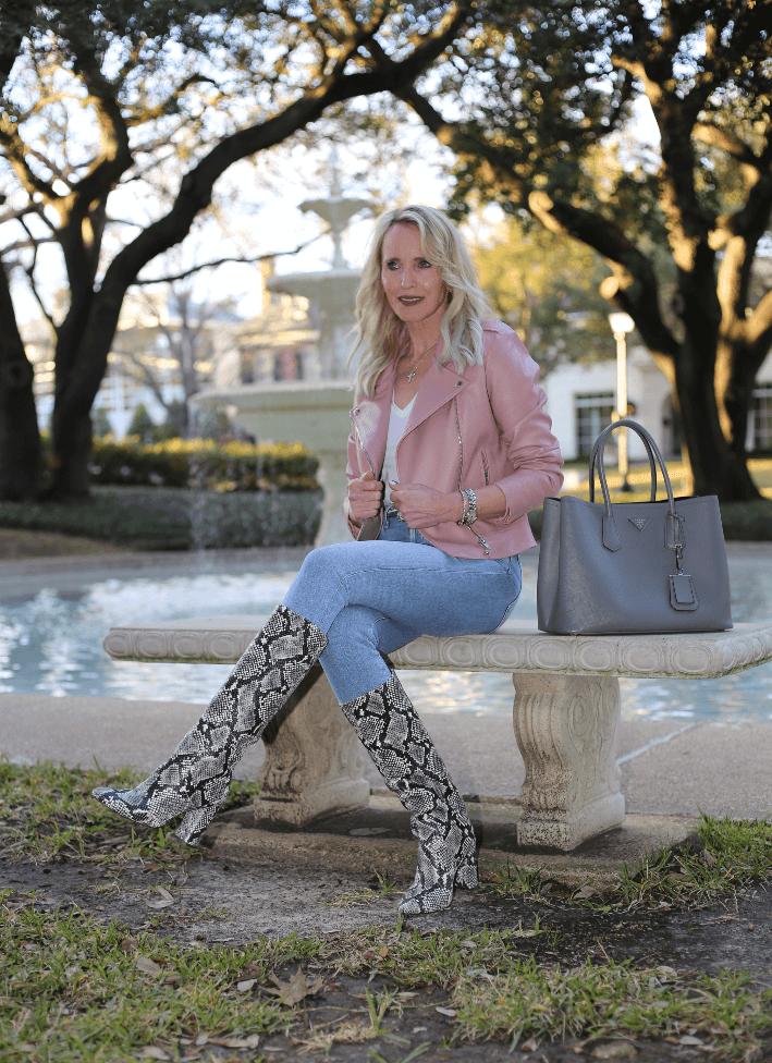 Dallas blogger Megan Saustad wearing BB Dakota faux leather moto jacket in mauve pink, Citizen of Humanity Jeans, snake print boots and carrying grey Prada Saffiano handbag.