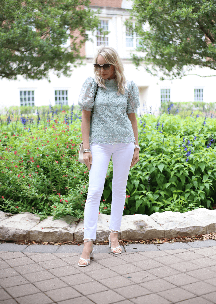 Dallas style blogger Megan Saustad wearing Agolde Nico White Denim Jeans, Chicwish Daisy Crochet Top in Mint Green, Alexandre Birman white Nelly sandals and carrying Saint Laurent Medium College Bag in white.