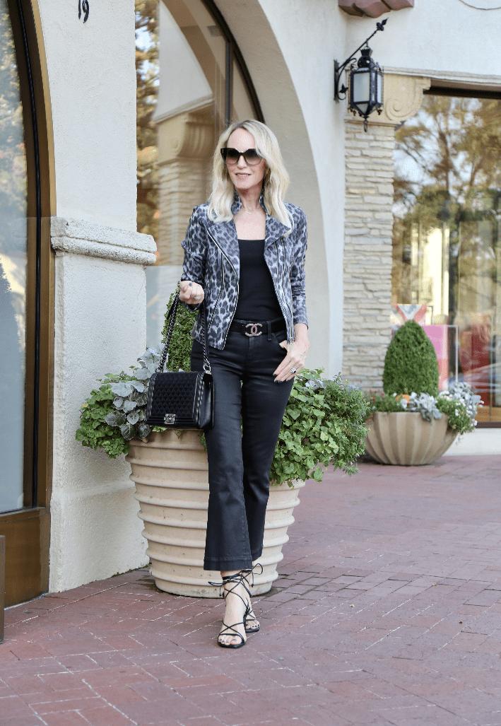 Dallas blogger Megan Saustad wearing Clara Sunwoo Liquid Leather Jacket, Frame Coated Jeans, Frame Doheney Sandal, Chanel Belt and carrying Chanel Boy Bag.