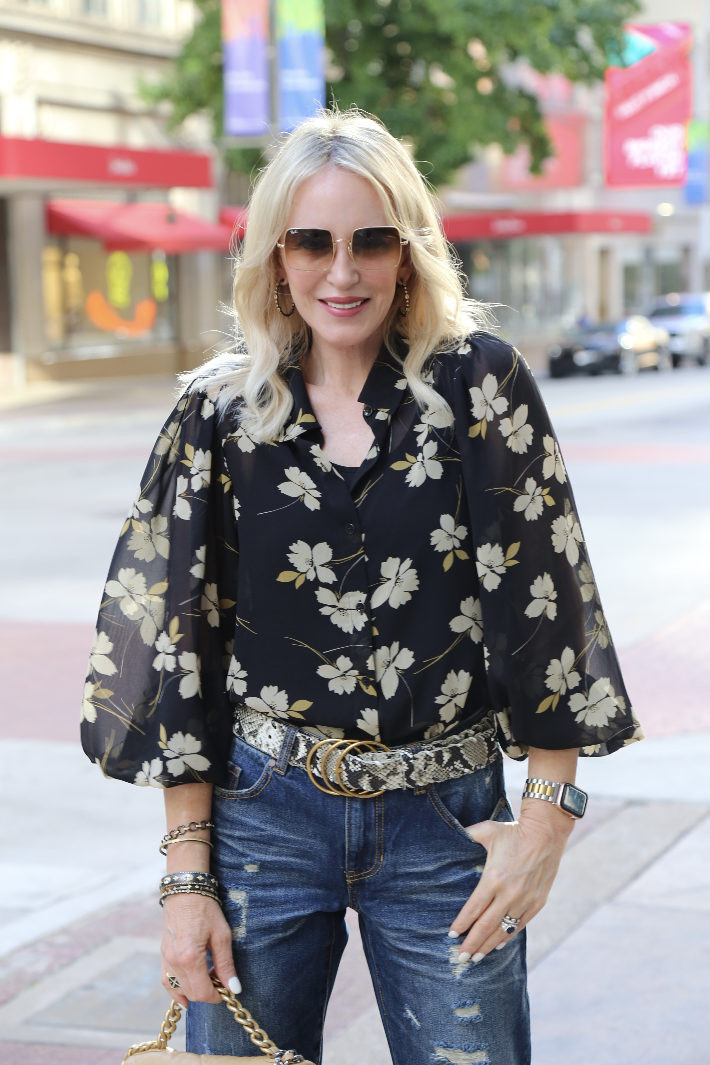 Dallas fashion blogger wearing the cabi Cosmo Blouse, Serpent Belt and 100% Boyfriend Jeans from the 2021 Fall Collection.
